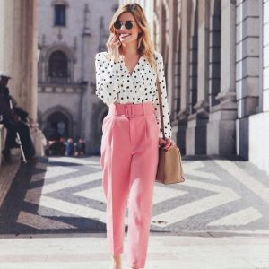 a-bright-spring-work-outfit-with-a-white-polka-dot-shirt-pink-pants-white-shoes-and-a-tan-bag-to-rock